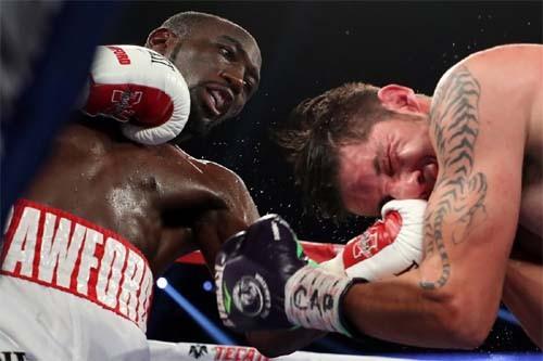 Чемпион мира поверсиям WBC иWBO Кроуфорд победил Молину